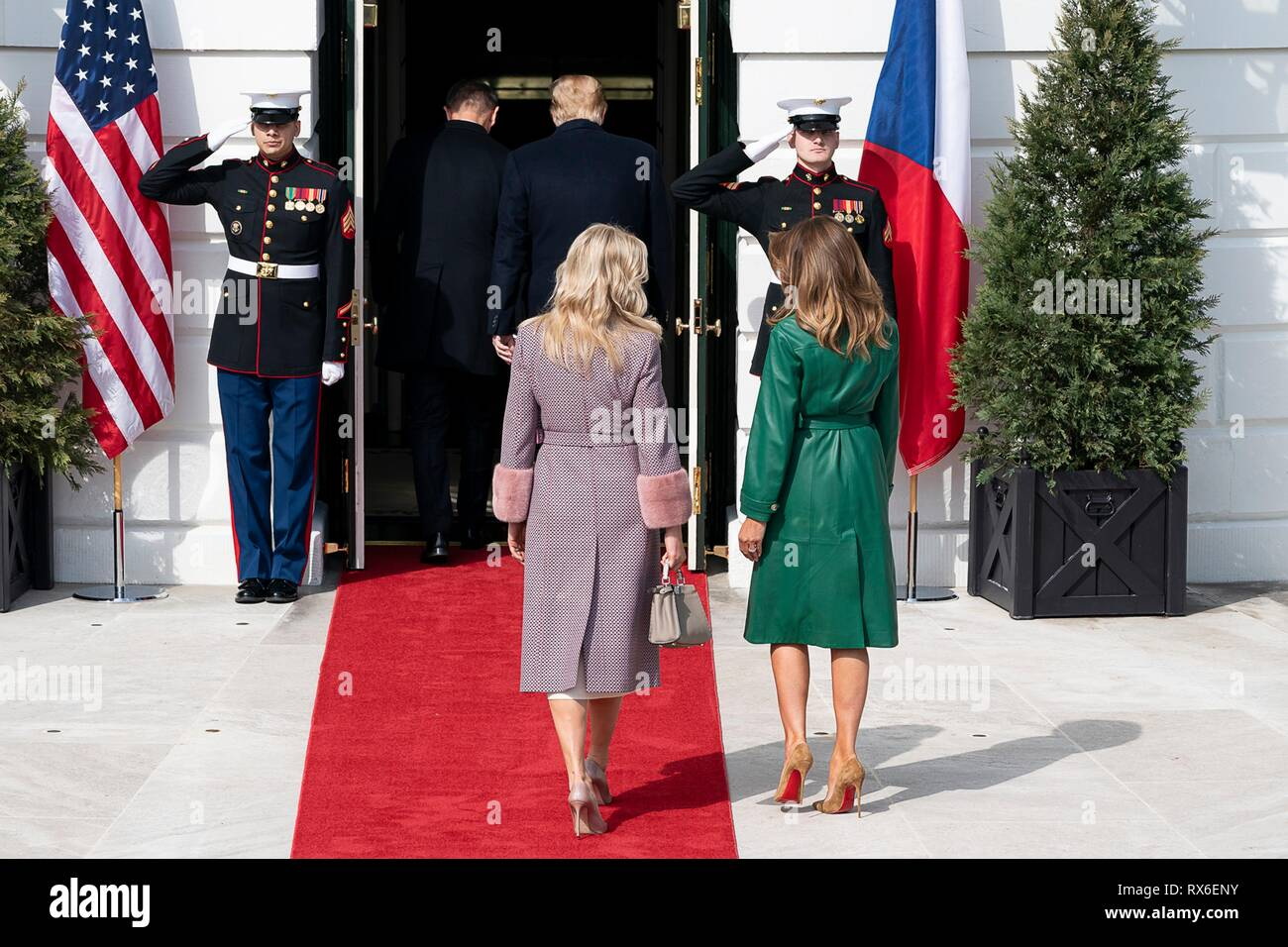 U.S President Donald Trump walks with Czech Prime Minister Andrej Babis and his wife Monika Babisova and First Lady Melania Trump chat during the arrival ceremony at the White House March 7, 2019 in Washington, DC. - Stock Image