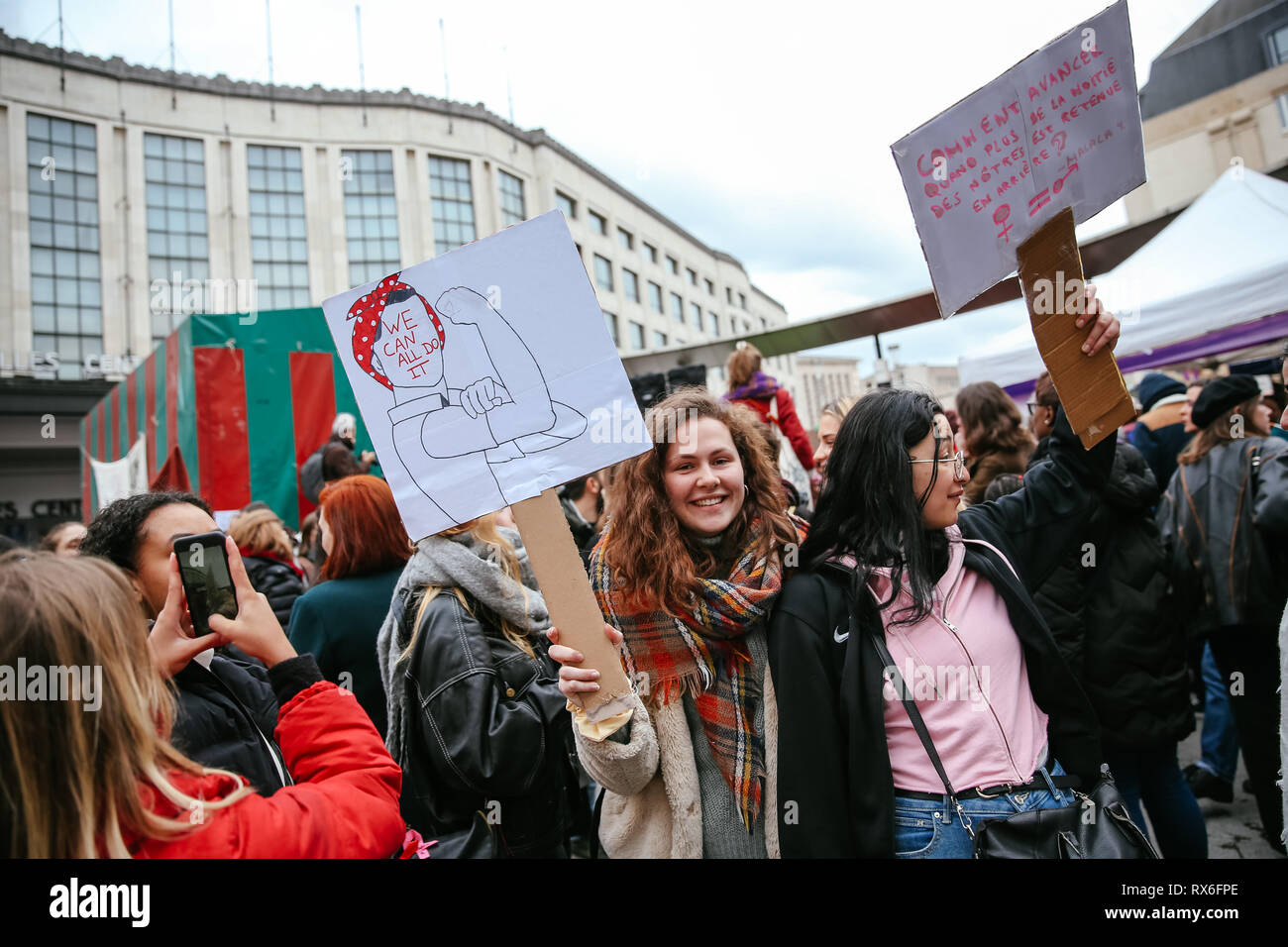 Brussels, Belgium. 8th Mar, 2019. People hold placards as they attend a women's strike in Brussels, Belgium, March 8, 2019. Thousands of women went on strike across Belgium on International Women's Day to campaign for women's rights and gender equality, local media reported. Credit: Zhang Cheng/Xinhua/Alamy Live News Stock Photo