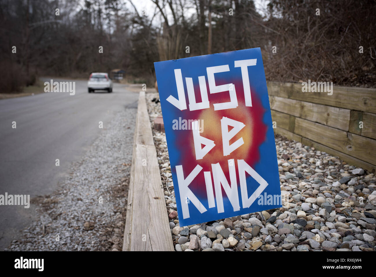 Ogden Dunes, IN, USA. 2nd Mar, 2019. A hand-painted 'Just Be Kind' sign is posted along a road in this small lakeshore community. It's a simple message that started in Central Indiana and is now spreading all over the world.The 'just be kind' group started back in 2015 as an after-school club for high school students. But when summertime rolled around, the students wanted to continue giving back.The students began making the items and then selling them for a profit, to give back to different area organizations. Credit: Robin Rayne/ZUMA Wire/Alamy Live News - Stock Image