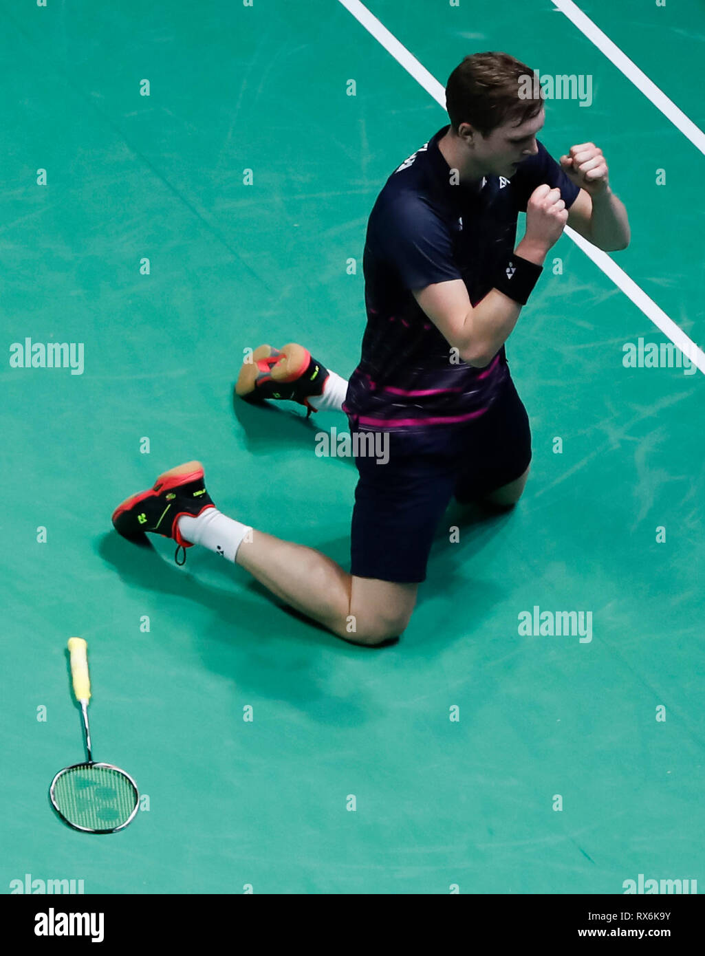 Birmingham. 8th Mar, 2019. Denmark's Viktor Axelsen celebrates after winning the men's singles quarterfinal match with his compatriot Jan O Jorgensen at the All England Open Badminton Championships 2019 in Birmingham, Britain on March 8, 2019. Credit: Han Yan/Xinhua/Alamy Live News - Stock Image