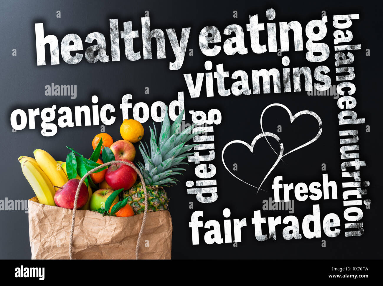 healthy eating word cloud with paper bag filled with fresh organic fruits - Stock Image