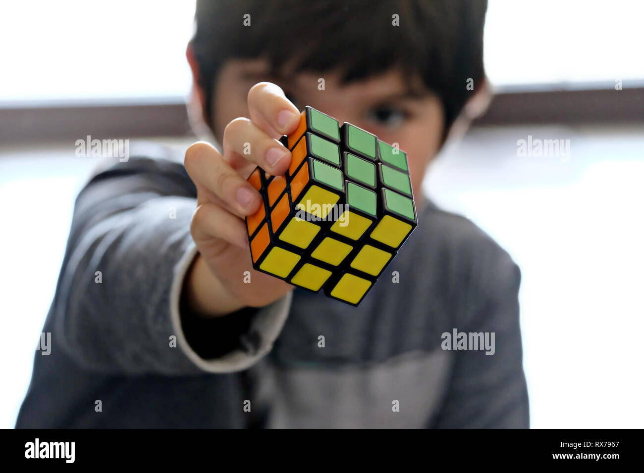 kid solved Rubik's cube - Stock Image