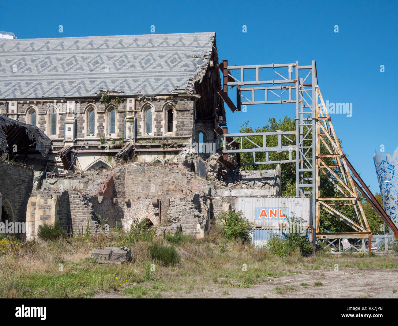 The earhquake damaged old Christchurch Cathedral New Zealand showing the metal protective scaffolding keeping it safe from further damage - Stock Image