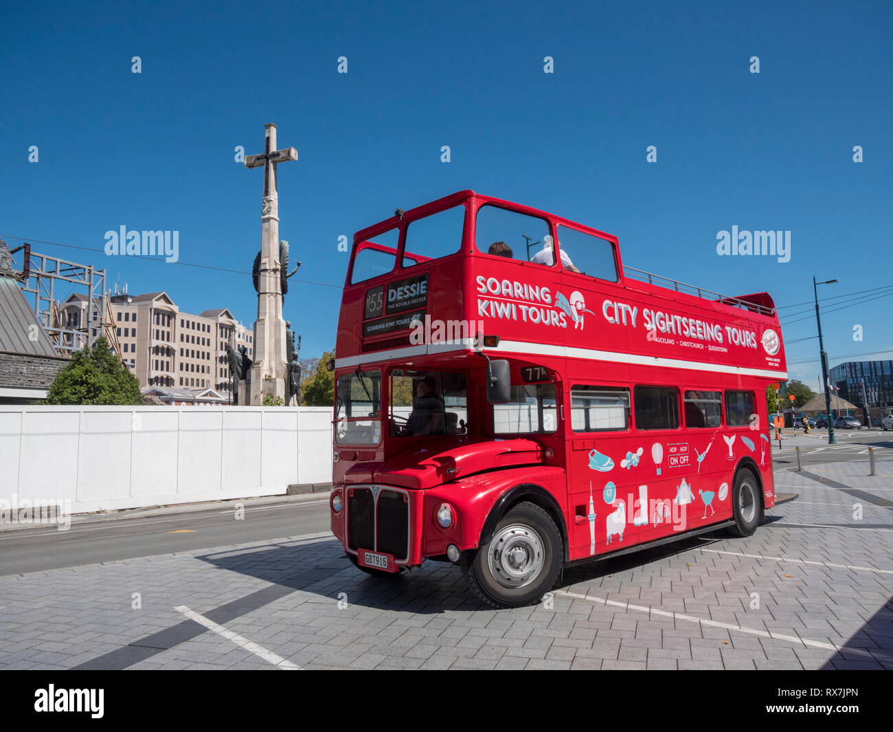 A red double decker bus used for sightseeing tours in Christchurch New Zealand parked waiting for passengers - Stock Image