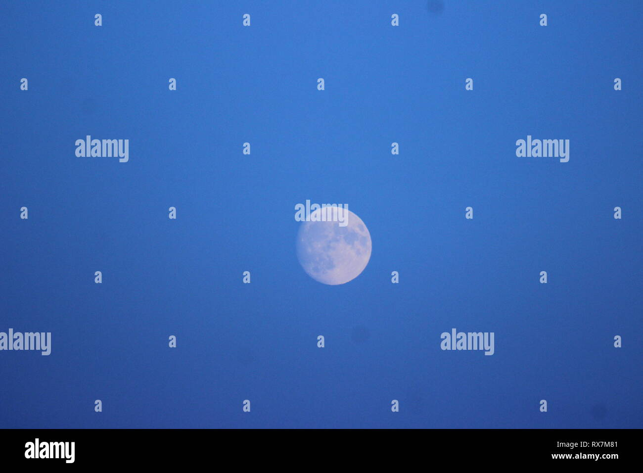 Evening Moon in the sky. - Stock Image