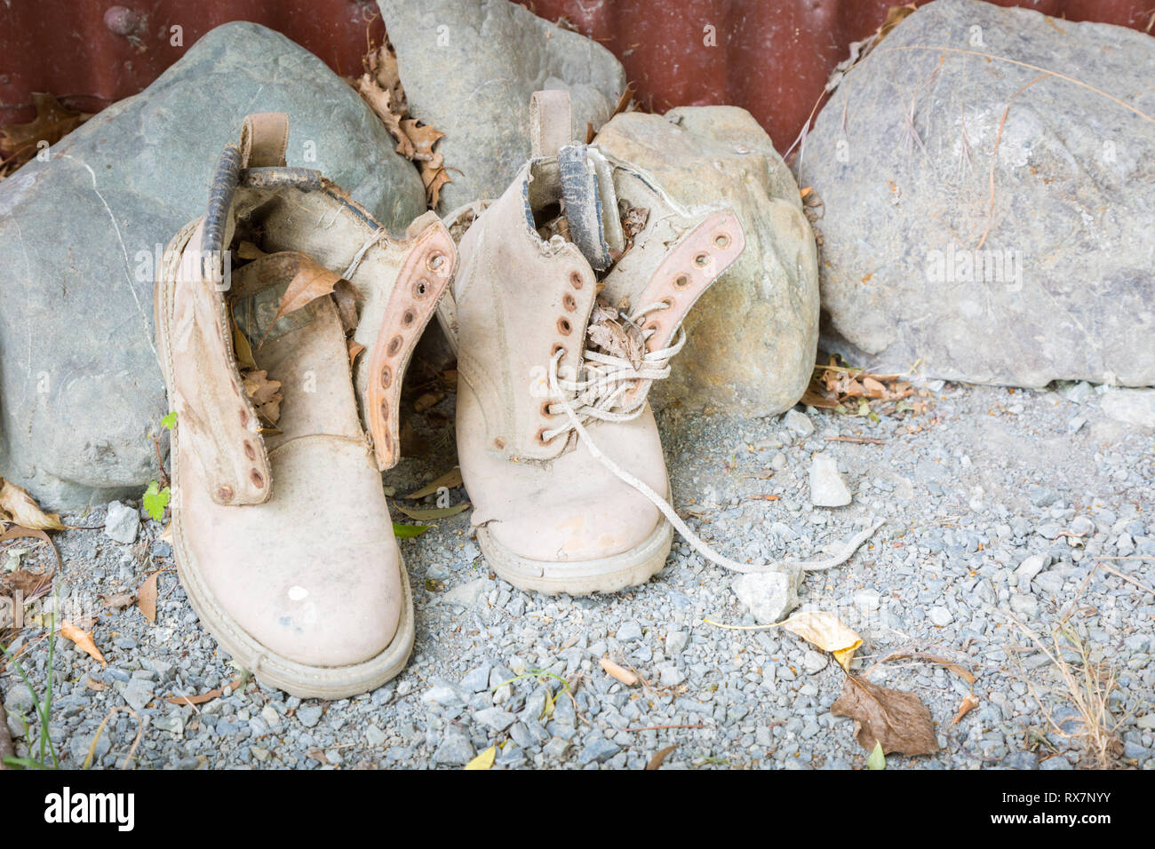 Pair of old work boots - Stock Image