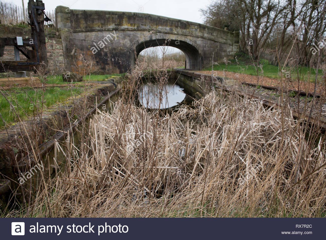 Skew bridge over a section of disused canal at Whappenshall Wharf in Telford Shropshire - Stock Image