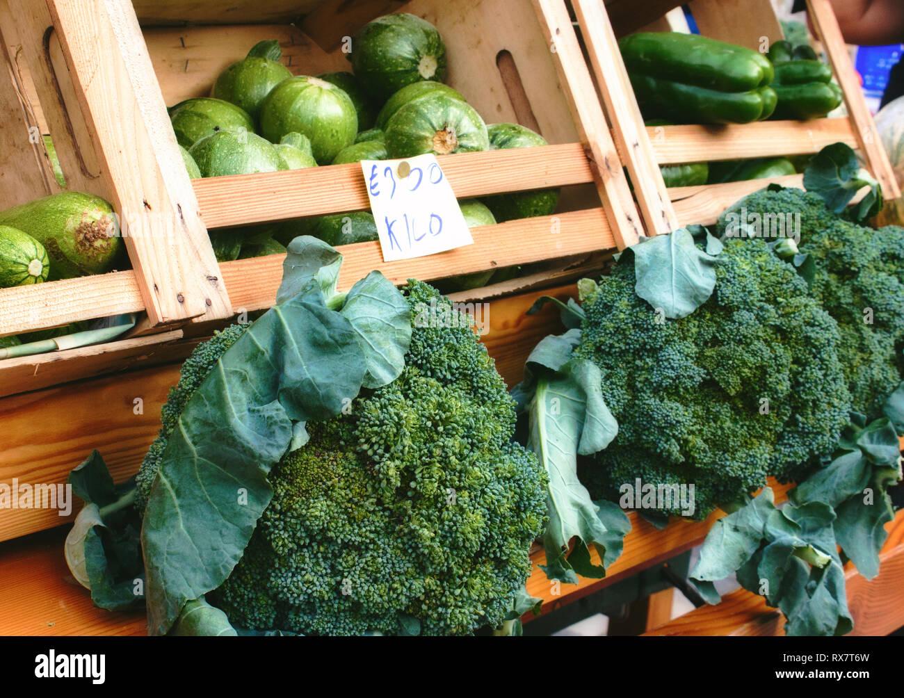 Market vendor cart with varied vegetables - Stock Image