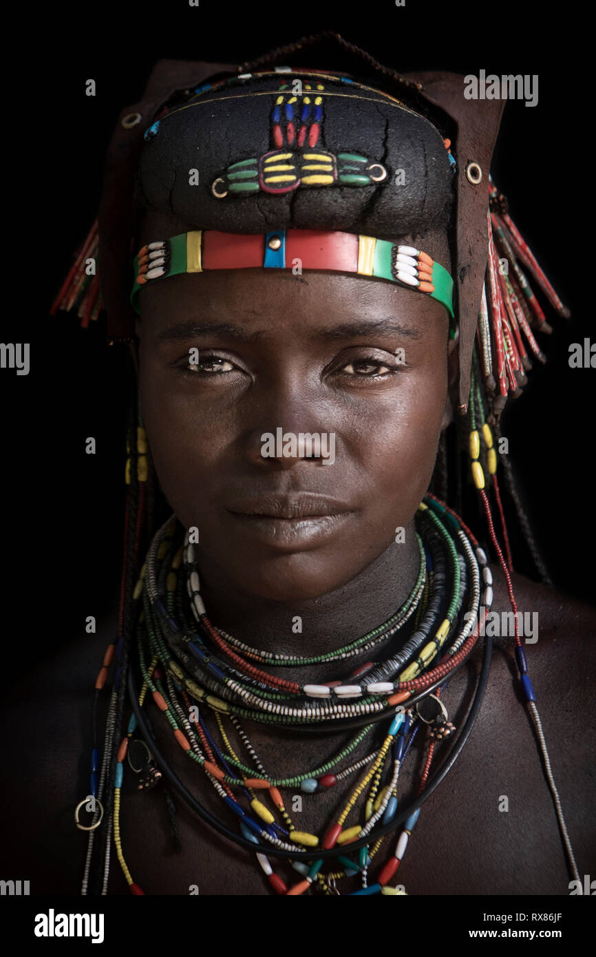 A Muhacaona woman showing her traditional adornments - Stock Image