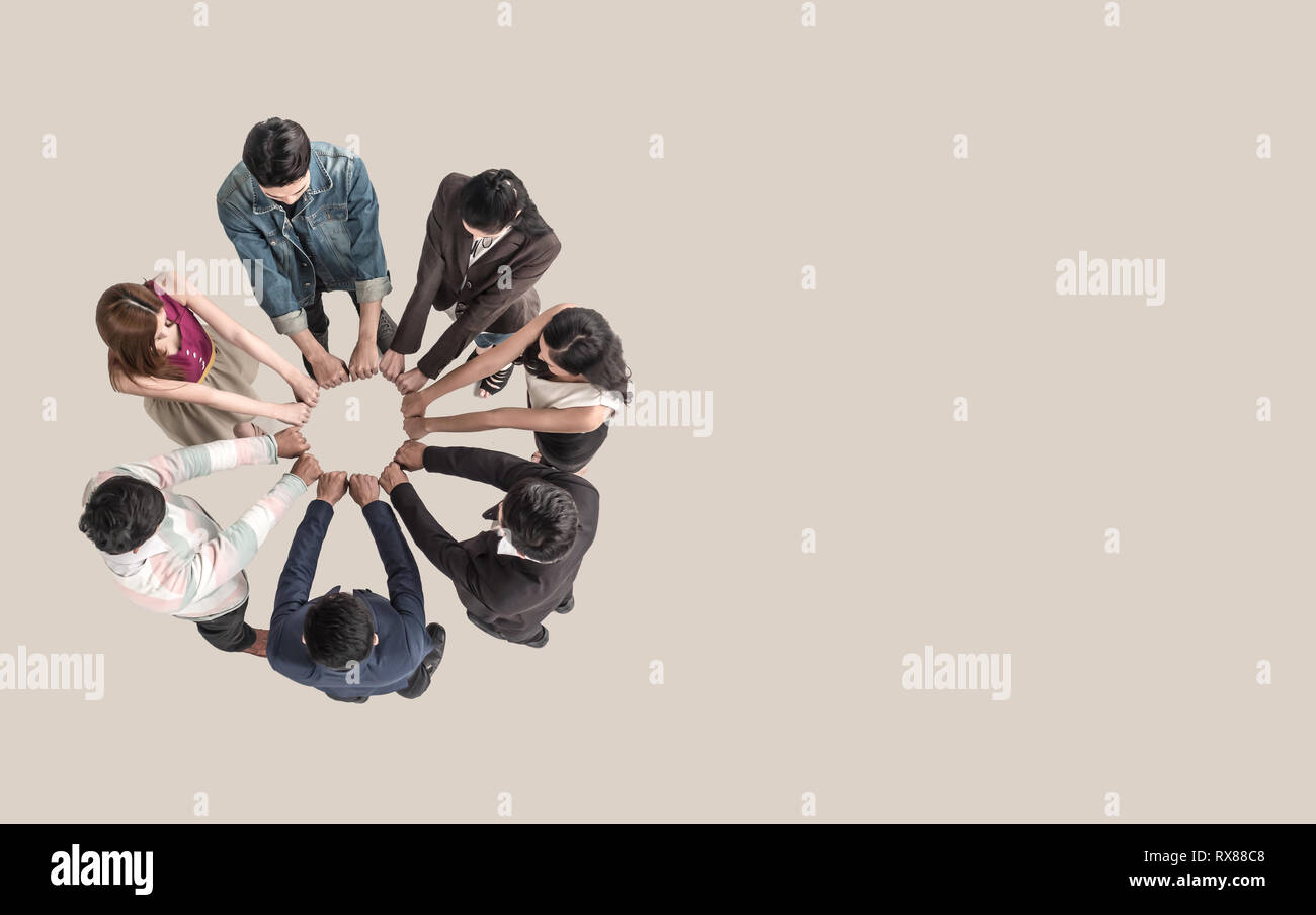 Top view of teen people in team fist bump assemble together. Stock Photo