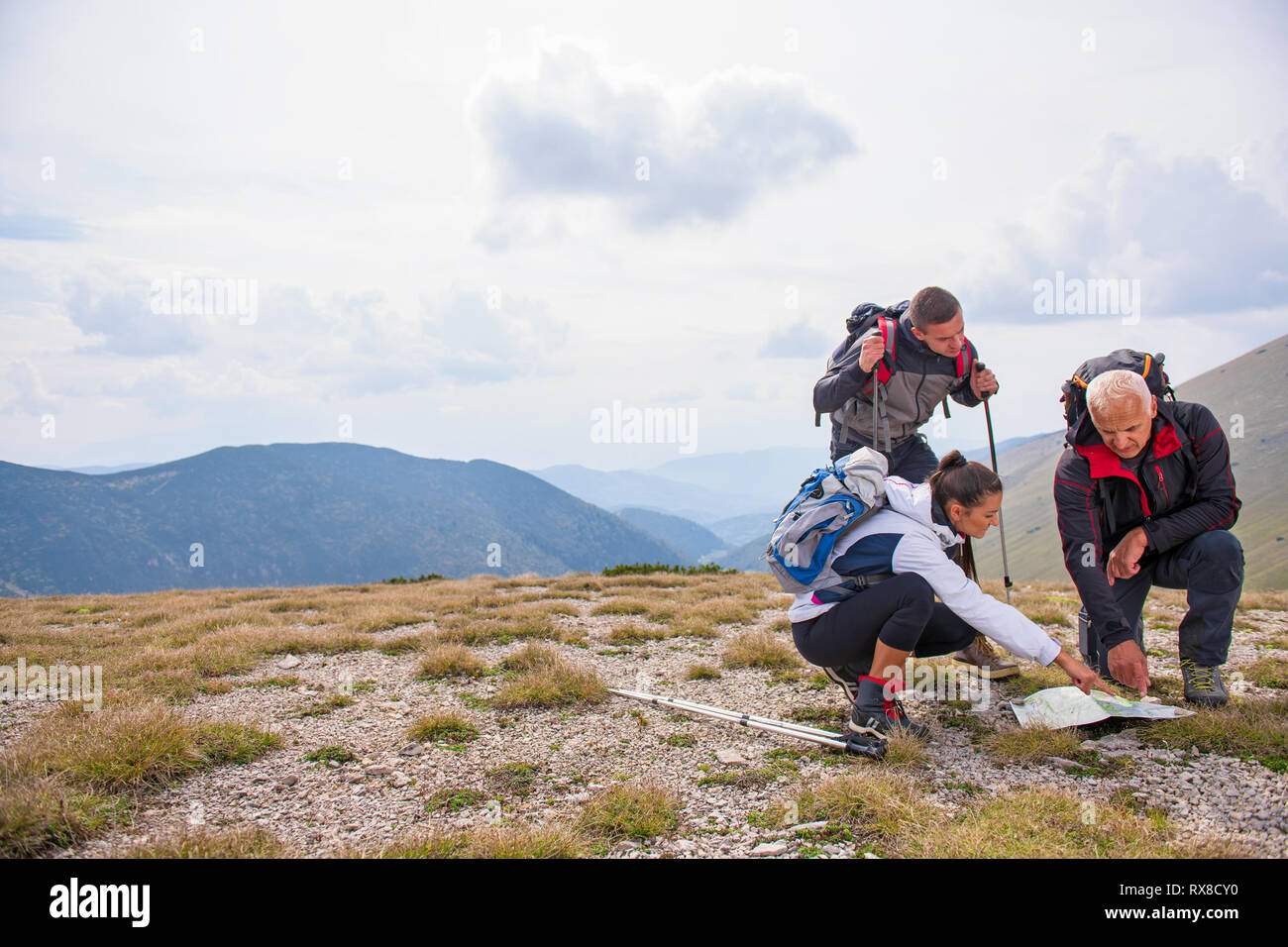 Adventure Travel Tourism Hike And People Concept Group Of Smiling Friends With Backpacks And Map Outdoors Stock Photo Alamy
