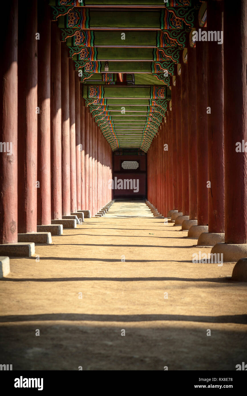 Diminishing perspective of corridor amidst columns in Gyeongbokgung - Stock Image