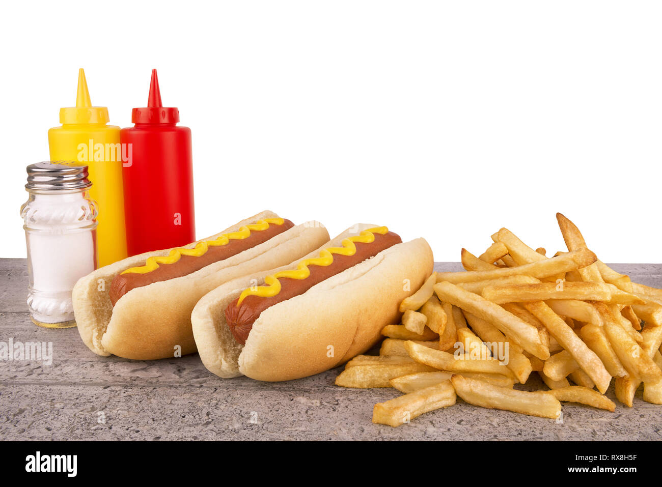 Duo of hot dogs and french fries on table. Fast food restaurant concept. Copy space for your text. - Stock Image