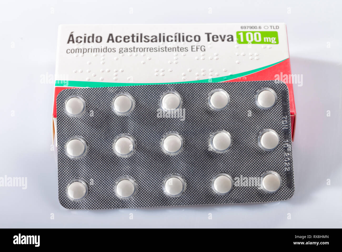 A box of acetylsalicylic acid tablets isolated on white. Infantile aspirin. Photo taken in Madrid, Spain, on March 8, 2019. - Stock Image