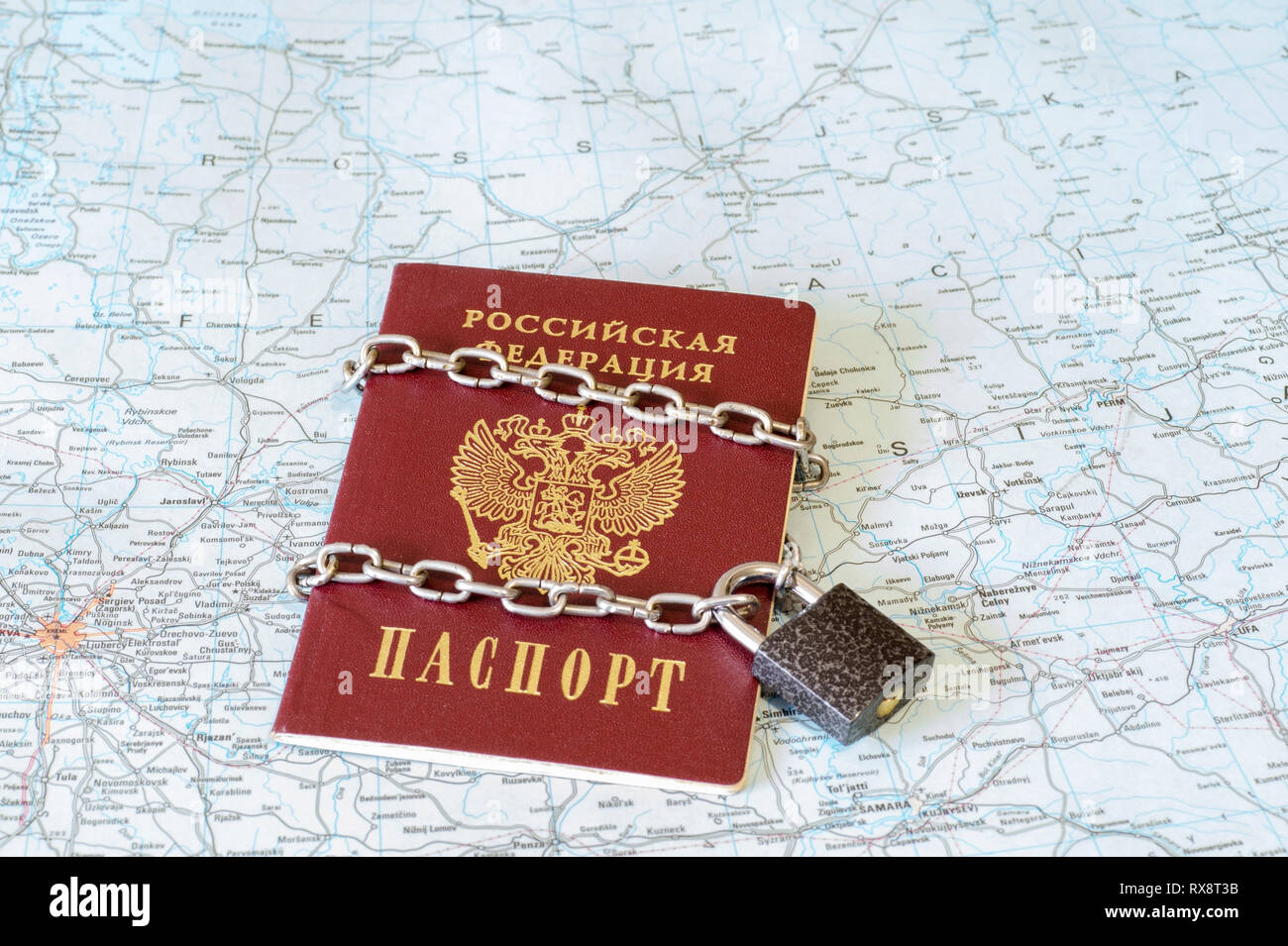 The concept of restriction of freedom of departure from the country, service and the ability to move abroad on the document of the citizen's identity. - Stock Image