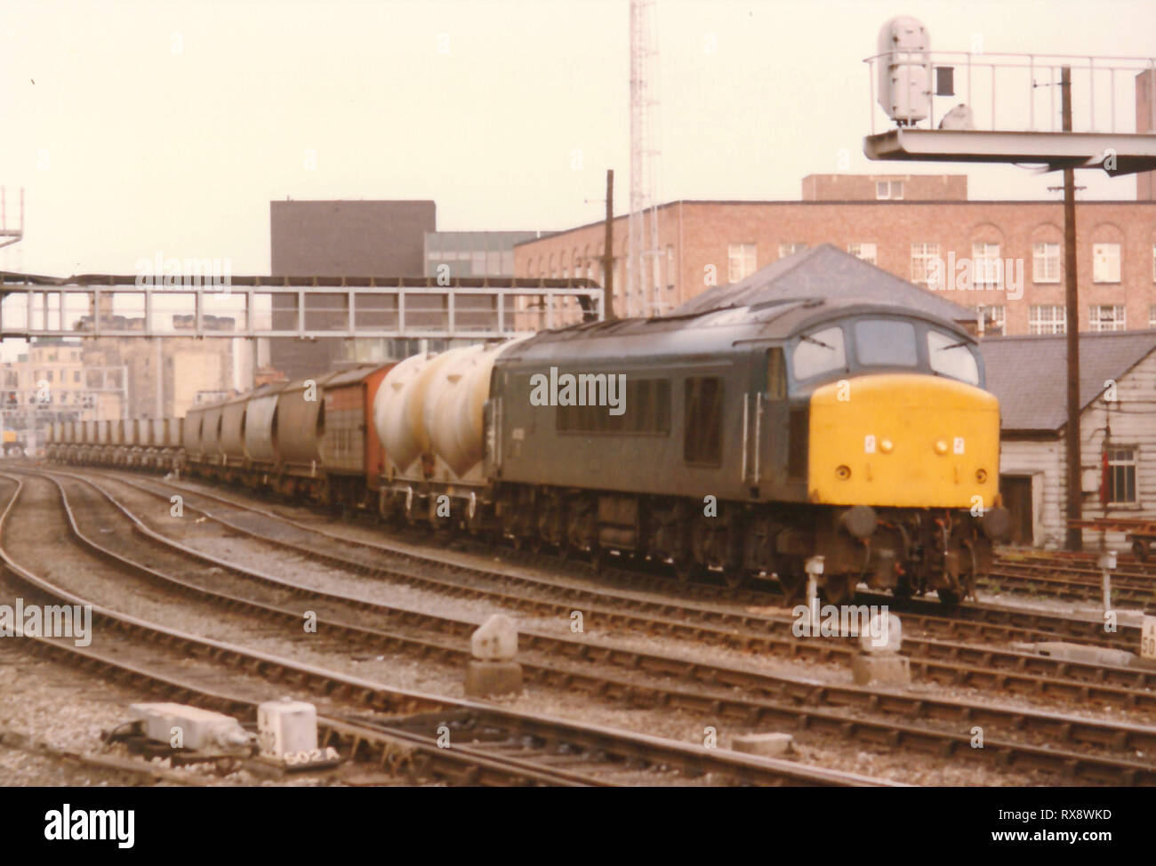 A Class 46 passes Newcastle Central Station with a southbound Speedlink service in the early 1980s. - Stock Image