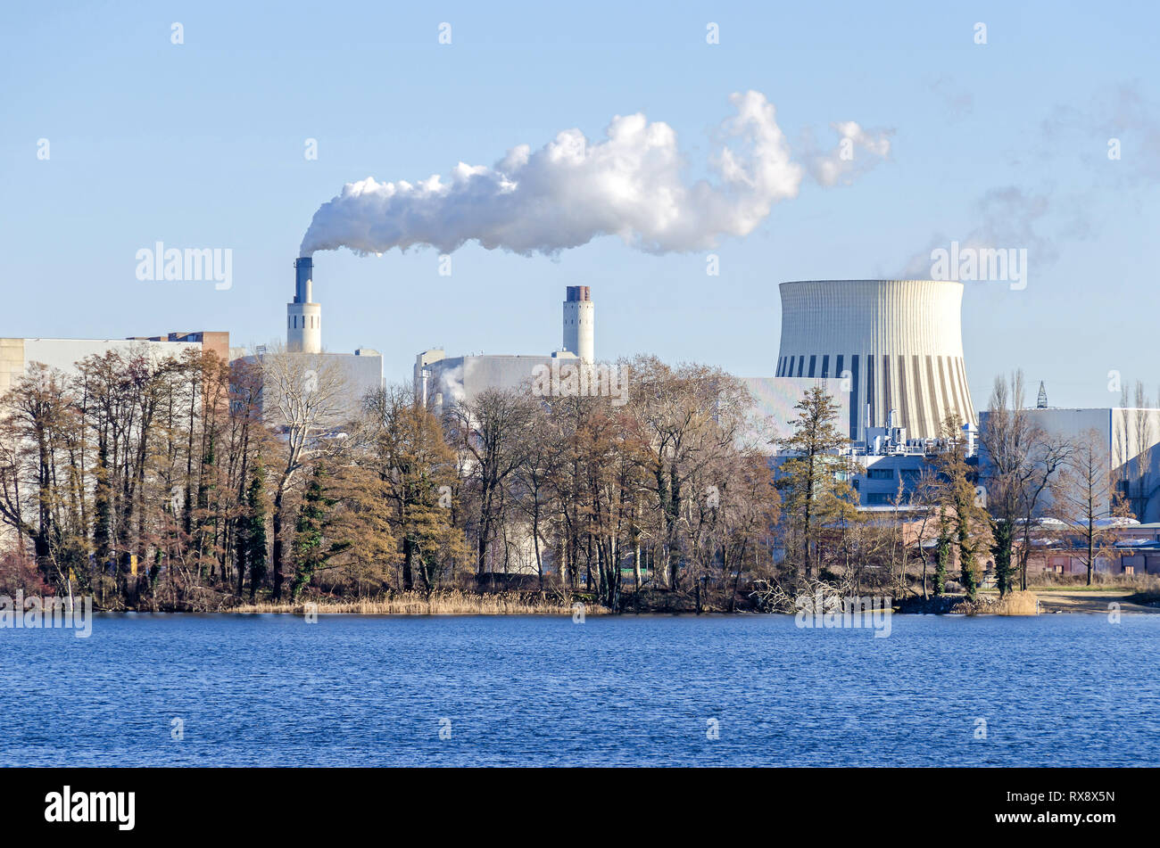 Berlin, Germany - February 22, 2019: Cooling tower and chimney stacks of the Reuter West environmentally compatible combined heat and power plant - Stock Image