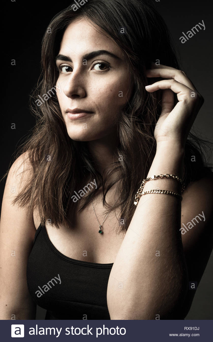Portrait confident beautiful brunette Latina young woman with brown eyes - Stock Image