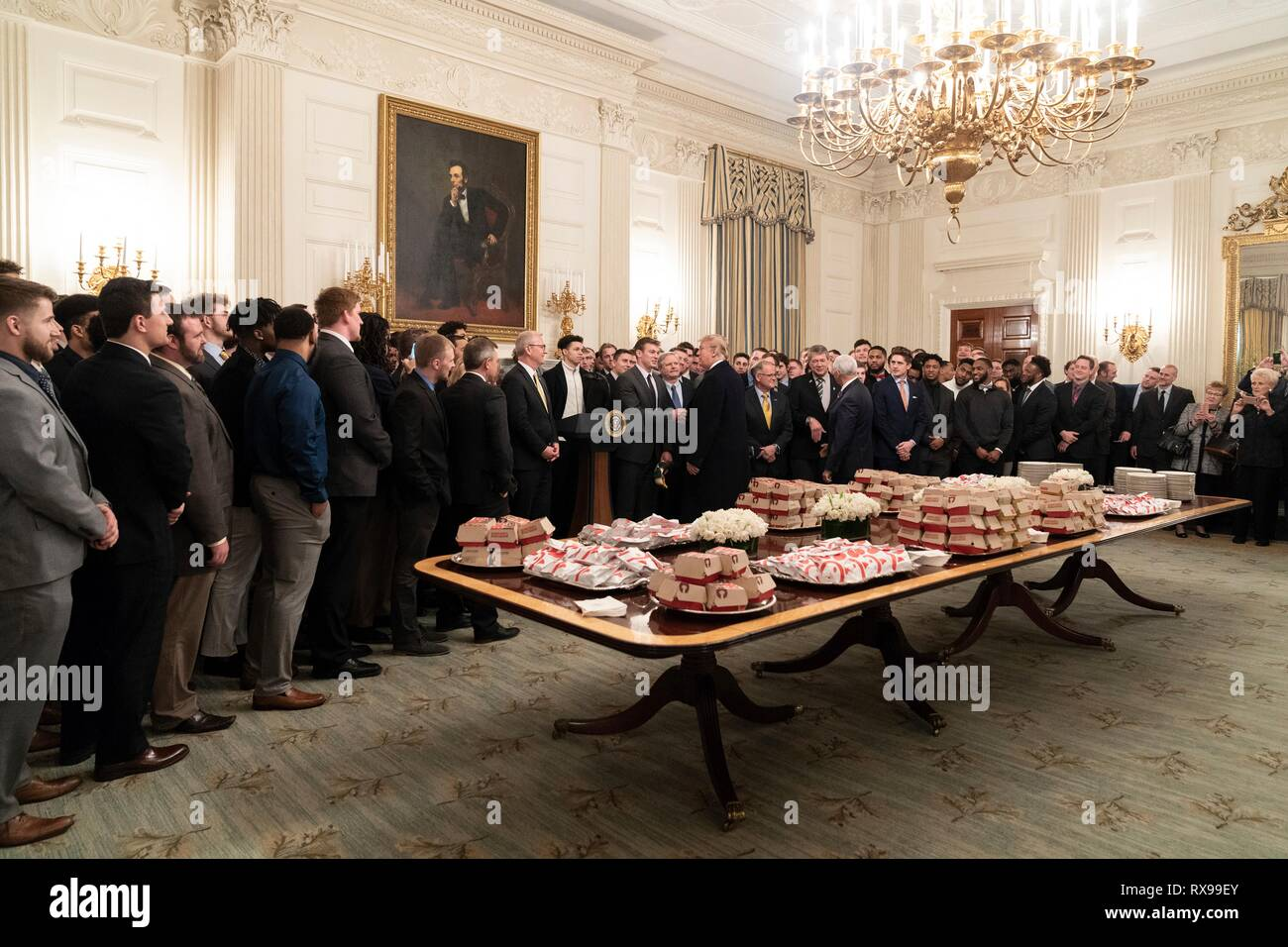 U.S President Donald Trump welcomes players with the 2018 FCS Division I Football National Champions North Dakota Bisons to a lunch of fast-food in the State Dining Room of the White House March 4, 2019 in Washington, DC. - Stock Image
