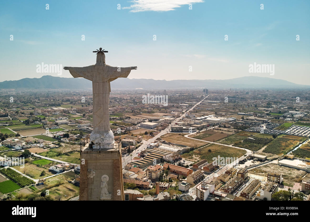 Aerial photo wide angle drone point of view Statue of Christ on a top of the limestone rock Monteagudo Castle fortress and cityscape of Murcia and sur - Stock Image