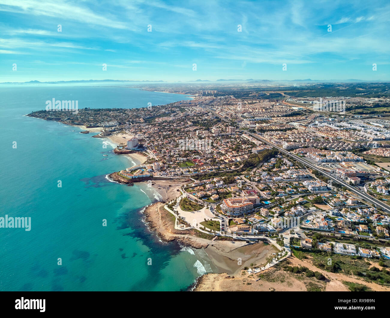 Costa Blanca view from above, drone point of view aerial photography. Turquoise green water rocky coastline, sandy beaches. Cityscape of Torrevieja, O - Stock Image