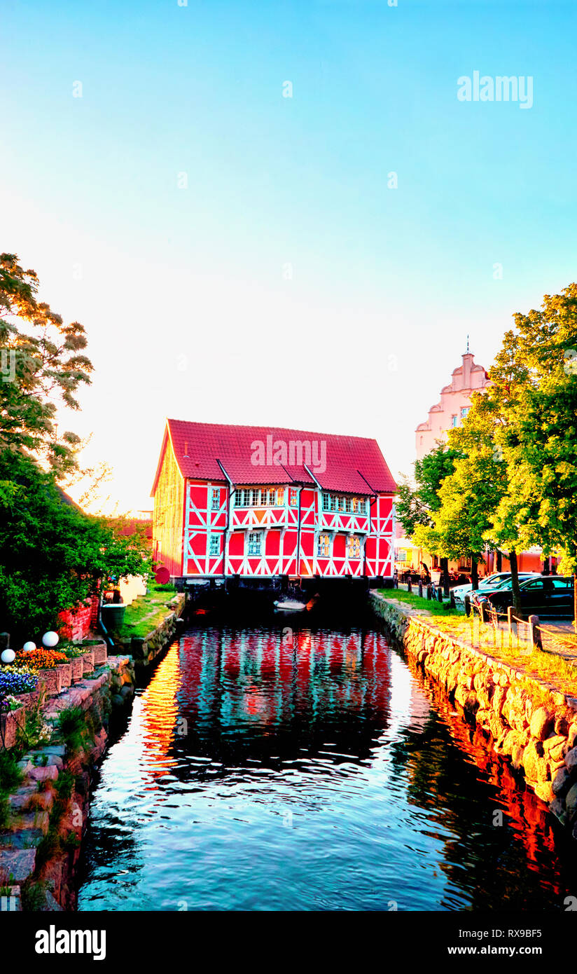 Canal in Wismar with old red half-timbered house. Baltic Sea in Mecklenburg-Vorpommern. Germany - Stock Image