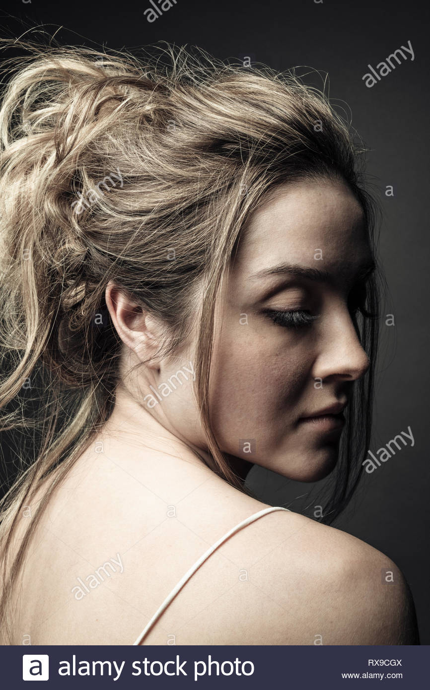 Serene beautiful young woman with blonde hair - Stock Image