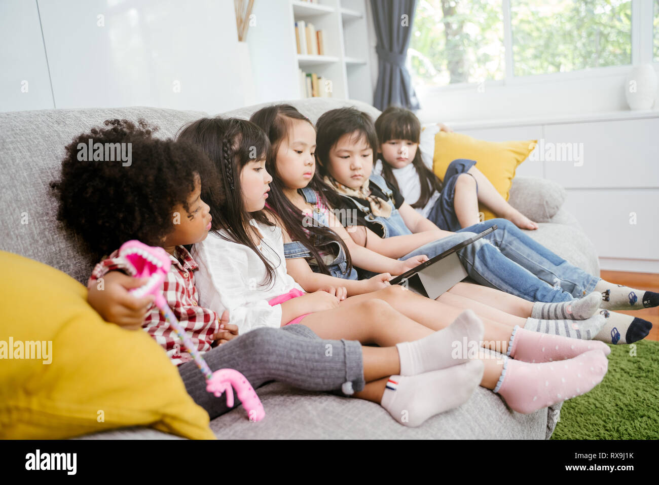 group of little children watching film movie cartoon