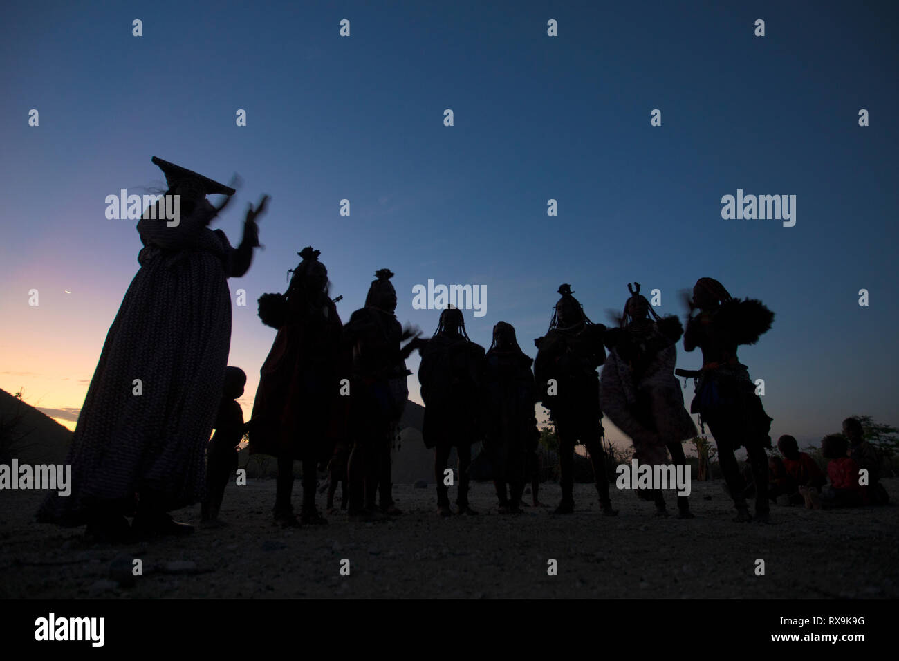 Himba and herero women dance together Stock Photo