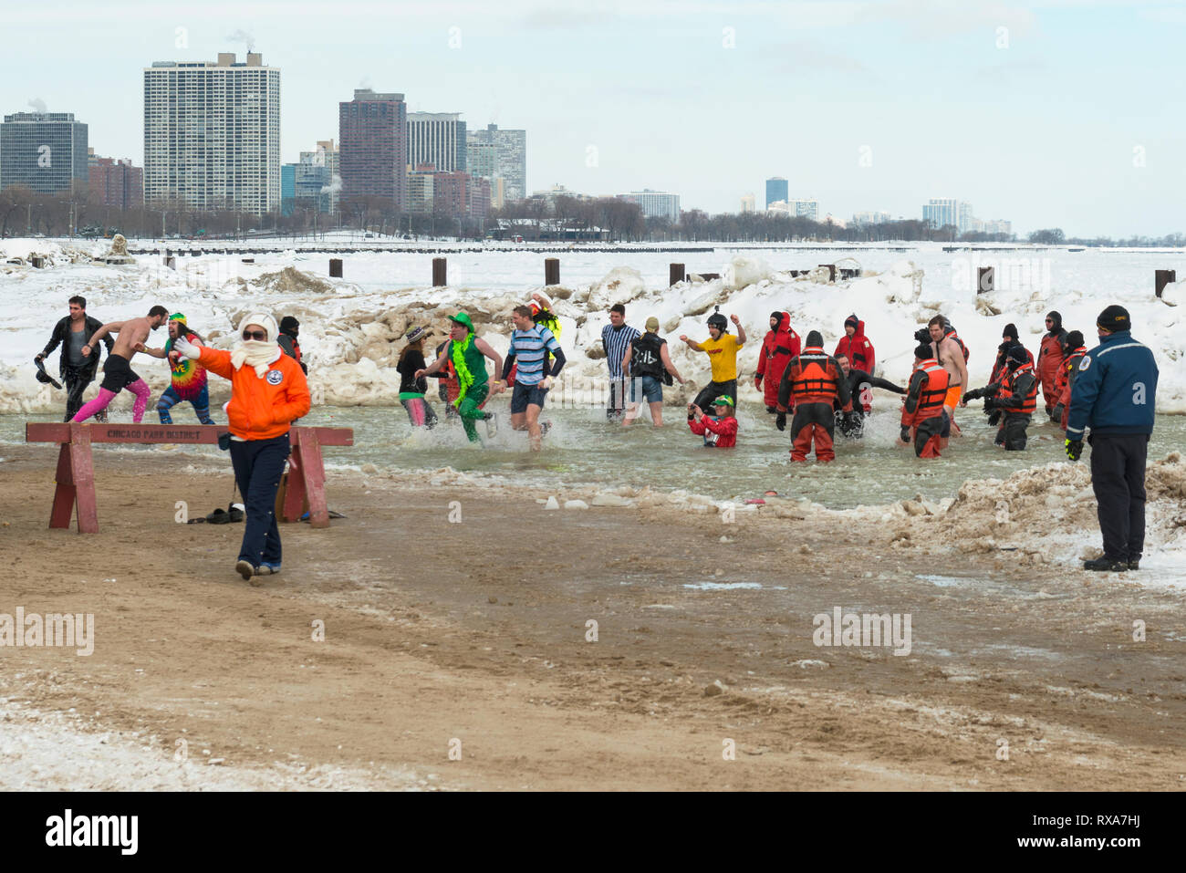 Chicago, IL  - March 2, 2014 - hundreds of brave Chicagoans showed up to jump into the freezing lake Michigan water at the Annual Polar Plunge event a - Stock Image