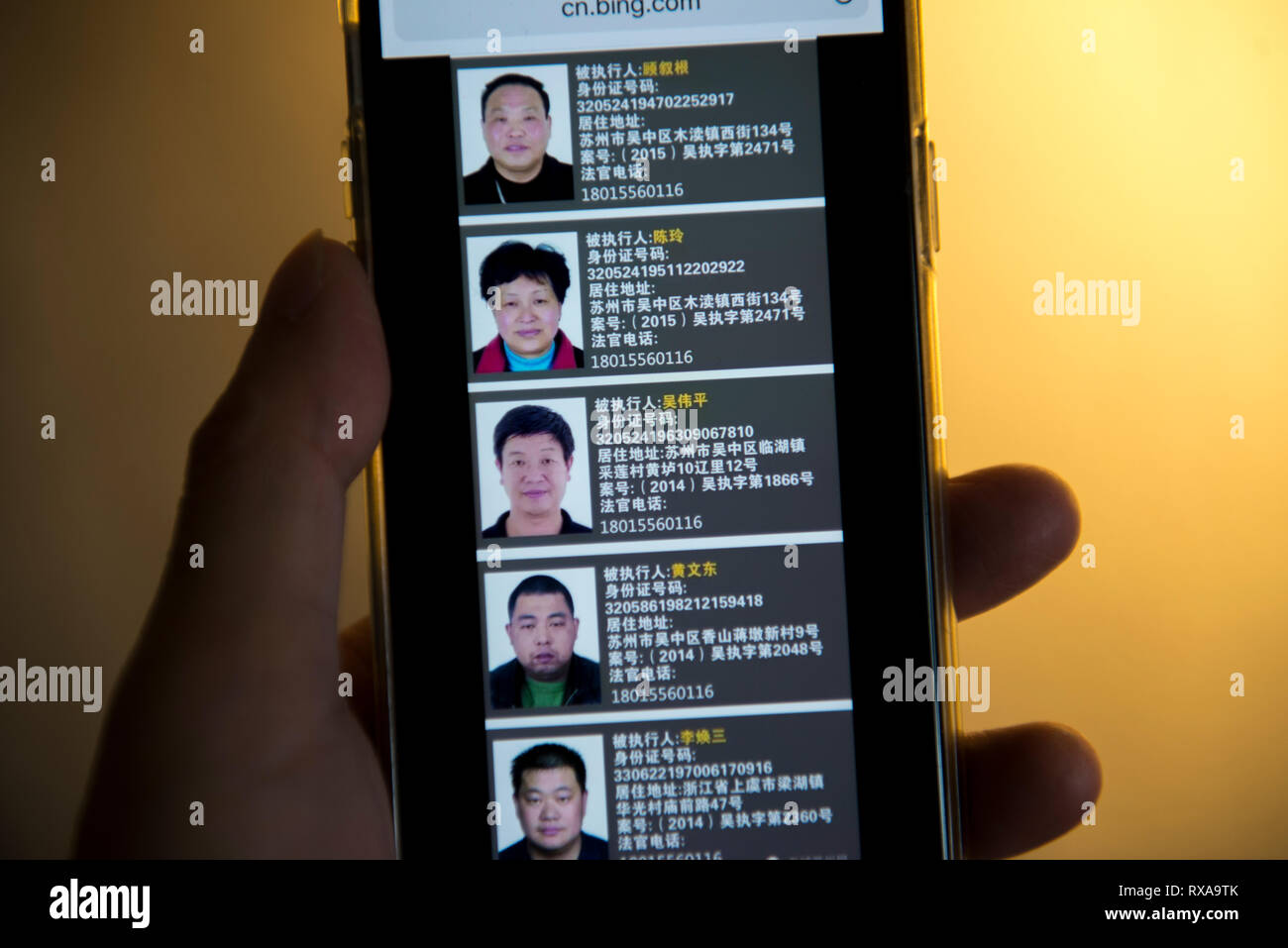Chinese local governments name and shame stubborn debtors by showing their pictures and personal information online. - Stock Image