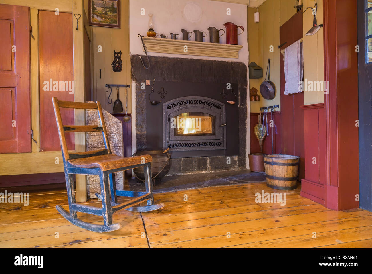 Picture of: Antique Wooden Rocking Chair Next To Black Cast Iron Wood Burning Fireplace Surrounded By A Natural