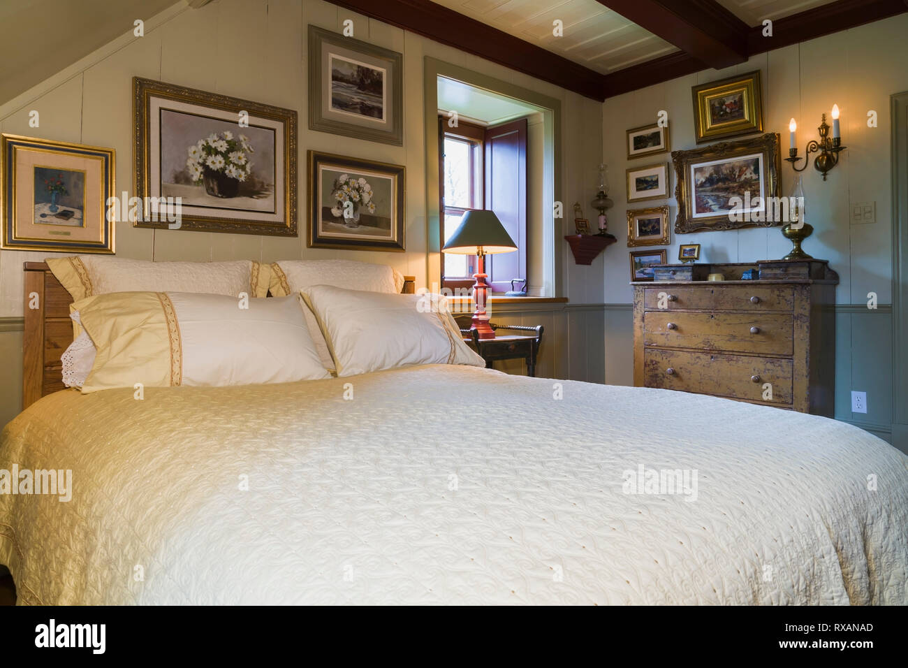Queen size bed with antique wooden headboard, dresser and ...