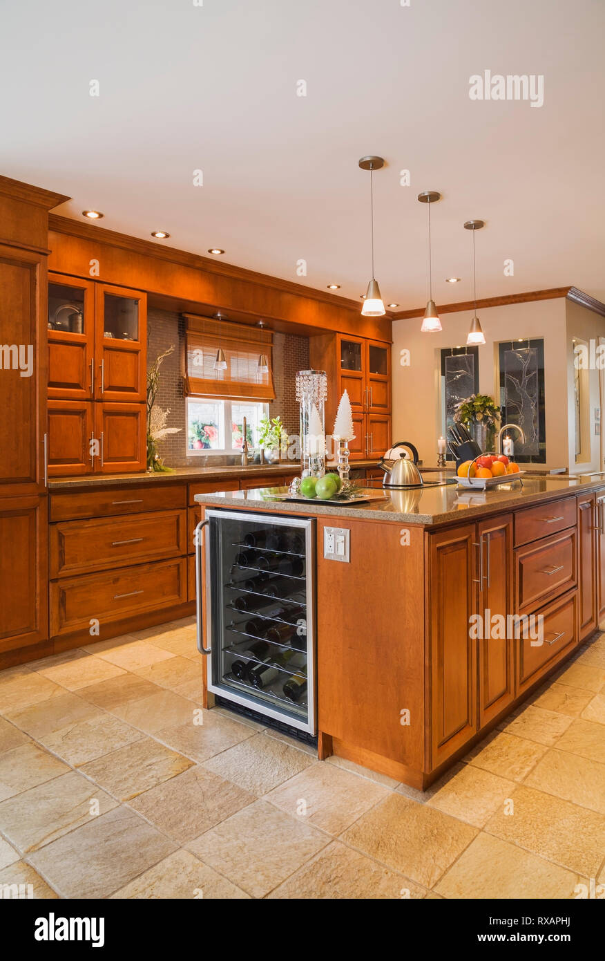 Cherrywood Cabinets And Island With Quartz Countertops In