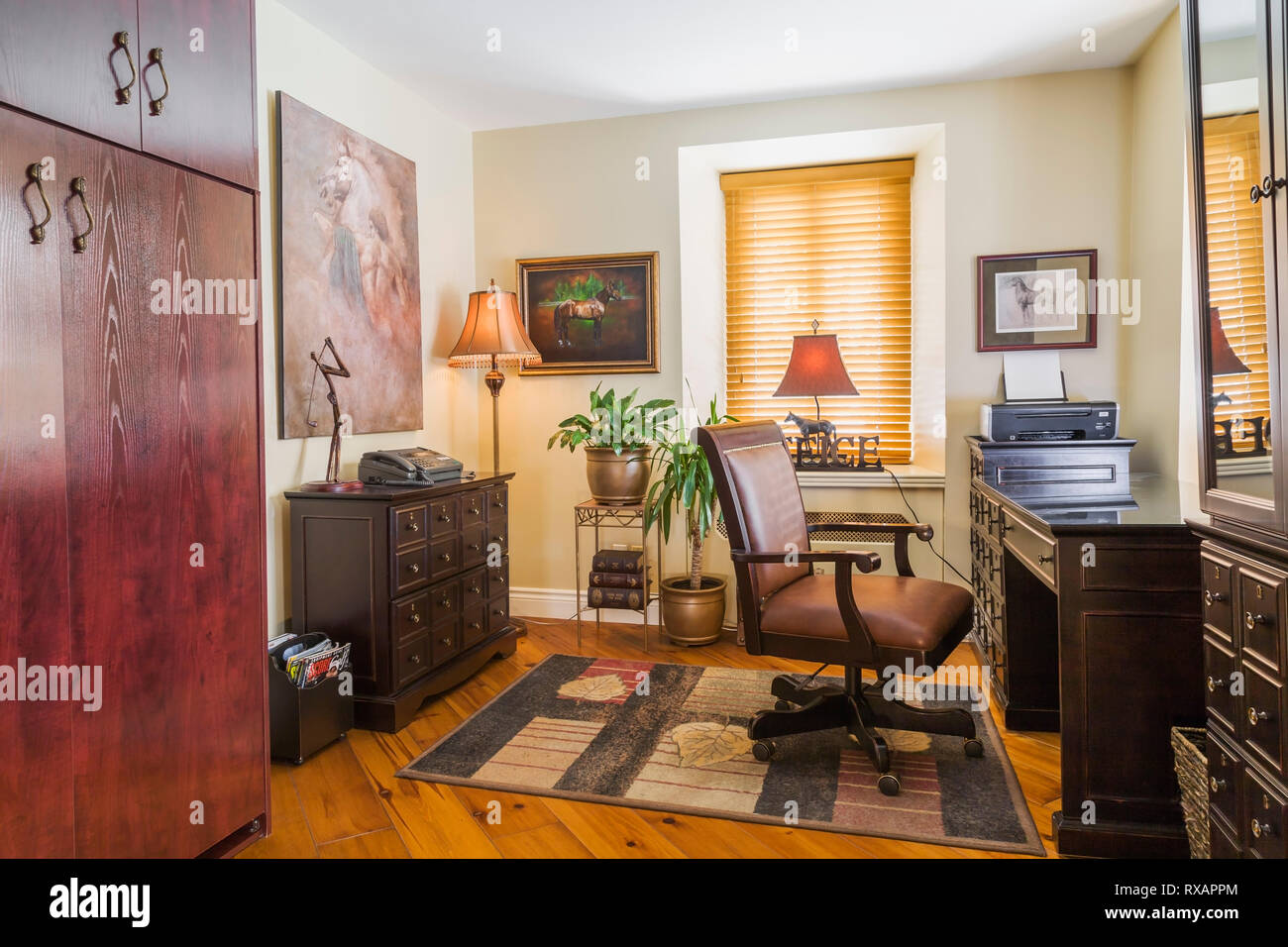 Home Office With Stately Brown Leather Chair And Desk In A