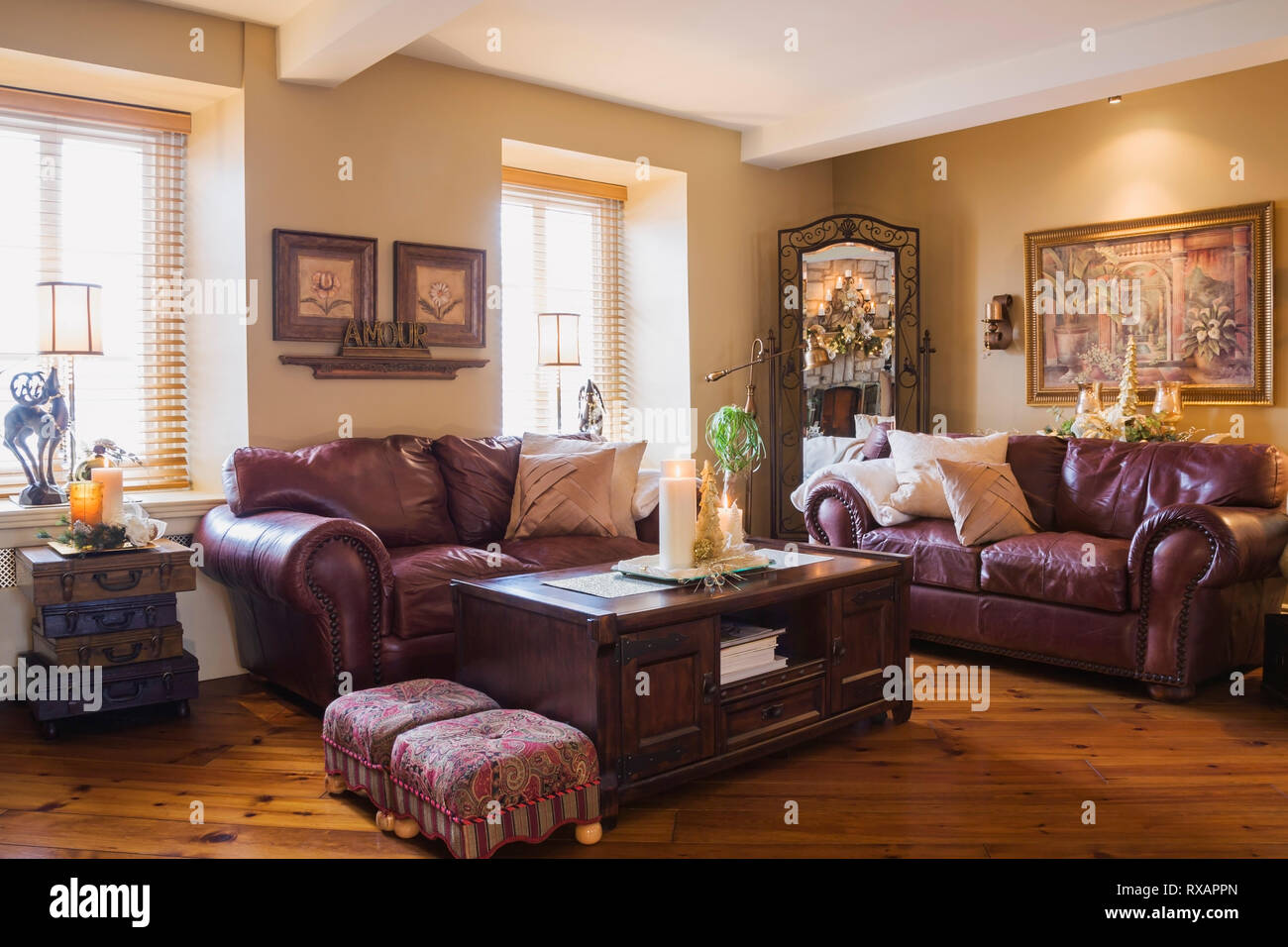 Burgundy leather sofas and wooden coffee table in living ...