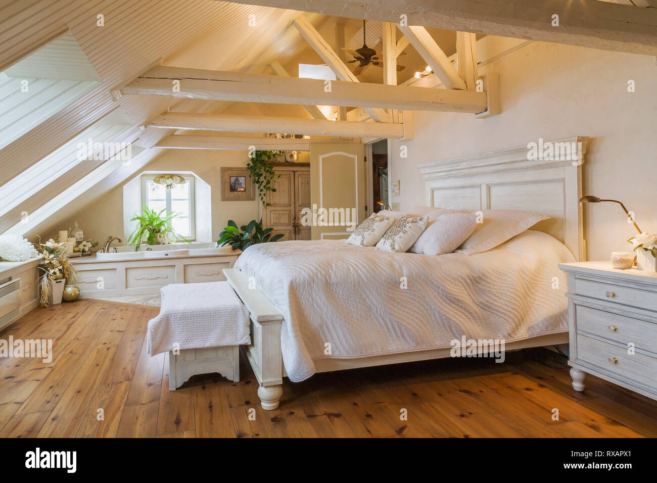 King size antique wooden bed in master bedroom in the attic of an ...
