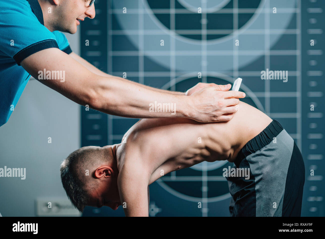 Scoliosis screening with scoliometer - Stock Image