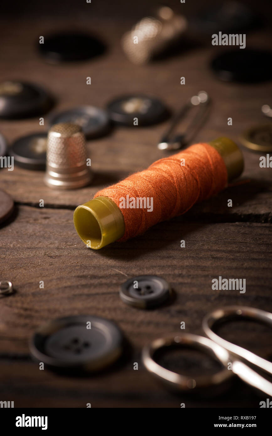 High angle view of various sewing items on fabric Stock Photo