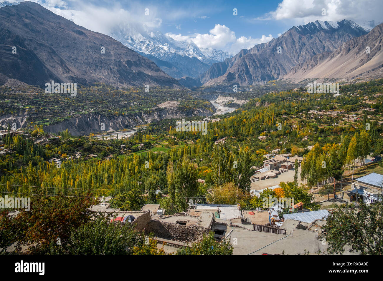 Landscape of peaceful Hunza Nagar valley in autumn with a view of snow capped Rakaposhi mountain in Karakoram range. Gilgit Baltistan, Pakistan. - Stock Image