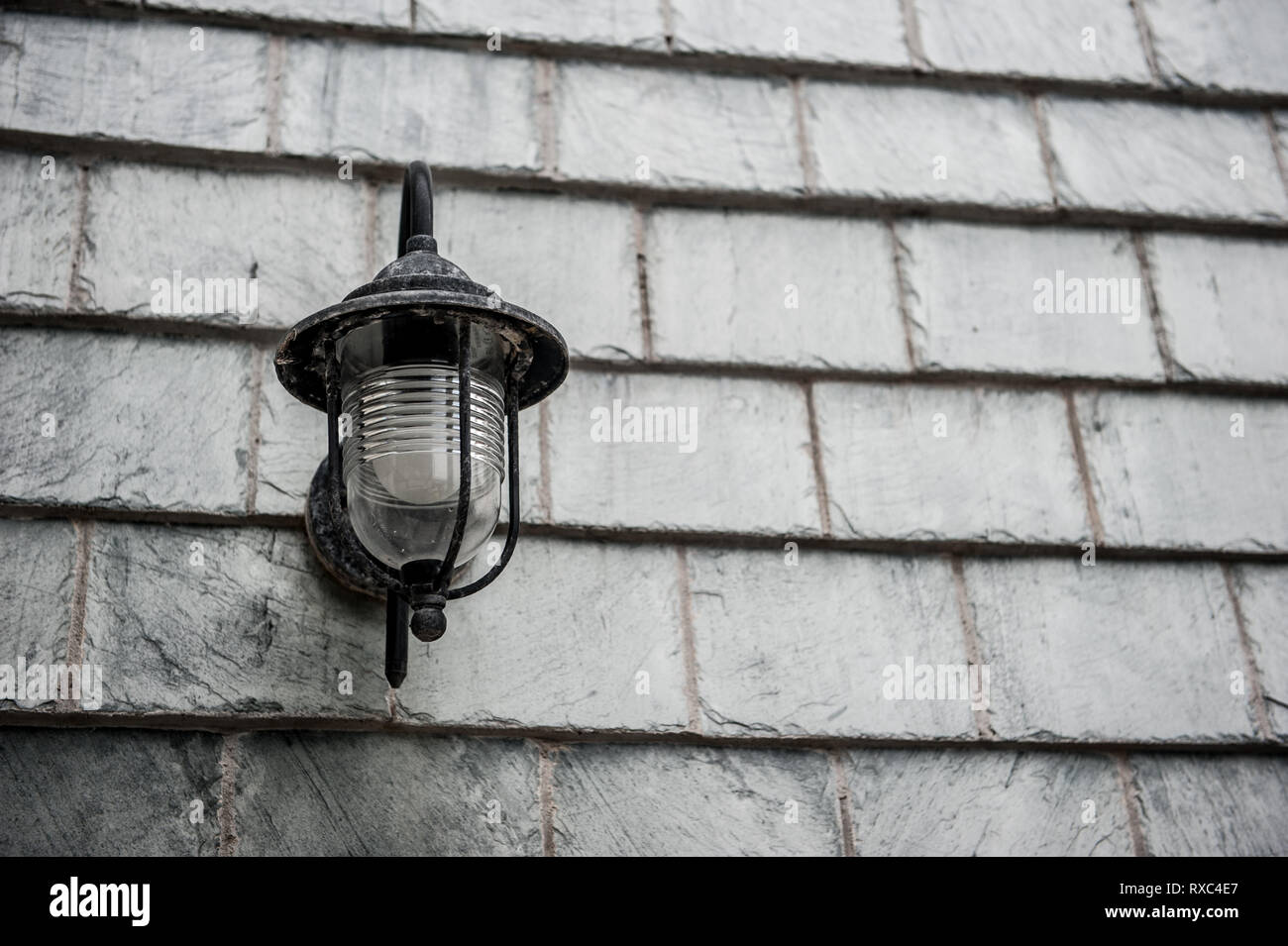 Vintage Industrial Outdoor Wall Lamp On A Grey Slate Wall With Space For Copy To The Right Stock Photo Alamy