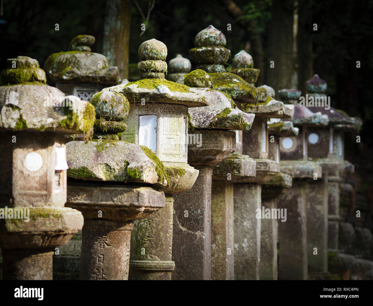 Nara, Japan - 15 Oct 2018: A row of weathered ancient stone structures near the Kasuga Grand Shrine at Nara, Japan - Stock Image