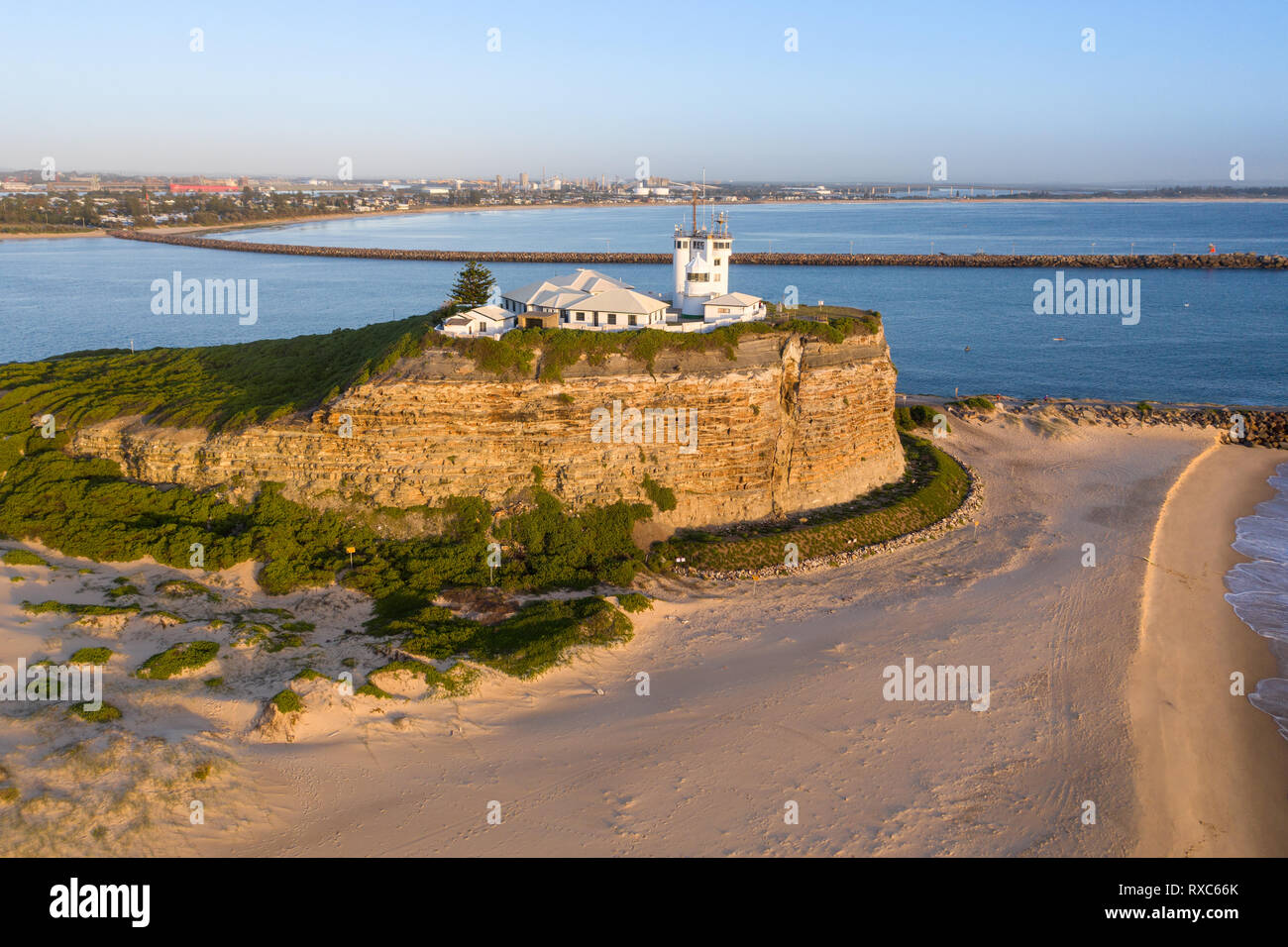 Aerial view at sunrise of Nobbys Lighthouse a prominent landmark in the Harbour City of Newcastle. - Stock Image
