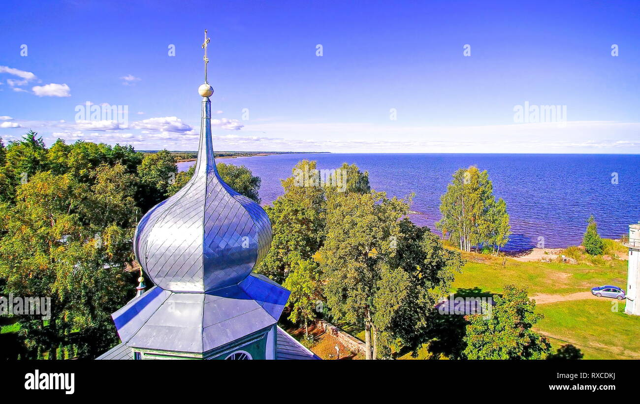 Landscape view of the lake fronting the church in Peipsi Estonia - Stock Image