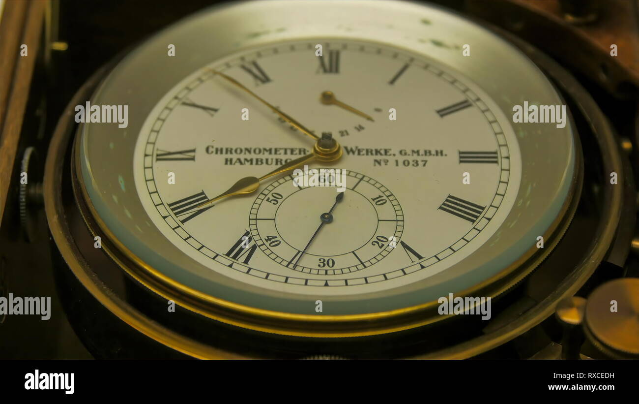A chronometer watch in the ship. A marine chronometer is a timepiece that is precise and accurate enough to be used as a portable time standard - Stock Image