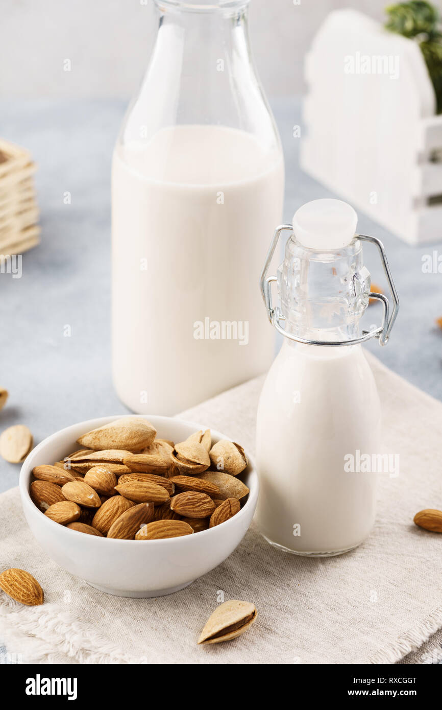 Homemade almond milk and raw ingredients. Healthy diet food. - Stock Image