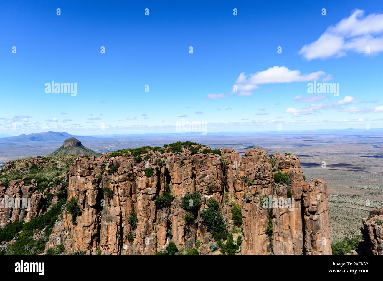 Sunny South Africa Graaff-Reinet,Valley of Desolation, Karoo, Camdeboo, panorama,impressive bizarre rocks under blue sky with some clouds, mountains - Stock Image