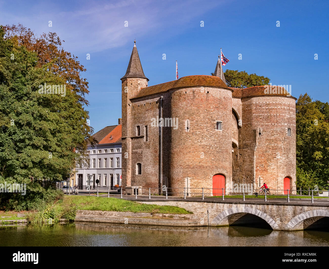 25 September 2018: Bruges, Belgium - The Gentpoort or Ghent Gate, a 15th Century part of the city's defences. Stock Photo