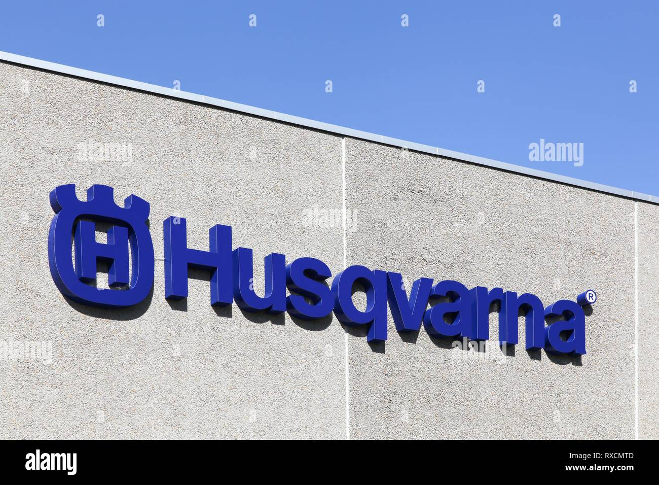 Randers, Denmark - May 5, 2018: Husqvarna logo on a facade. Husqvarna is swedish a manufacturer of robotic mowers, garden tractors and chainsaws - Stock Image