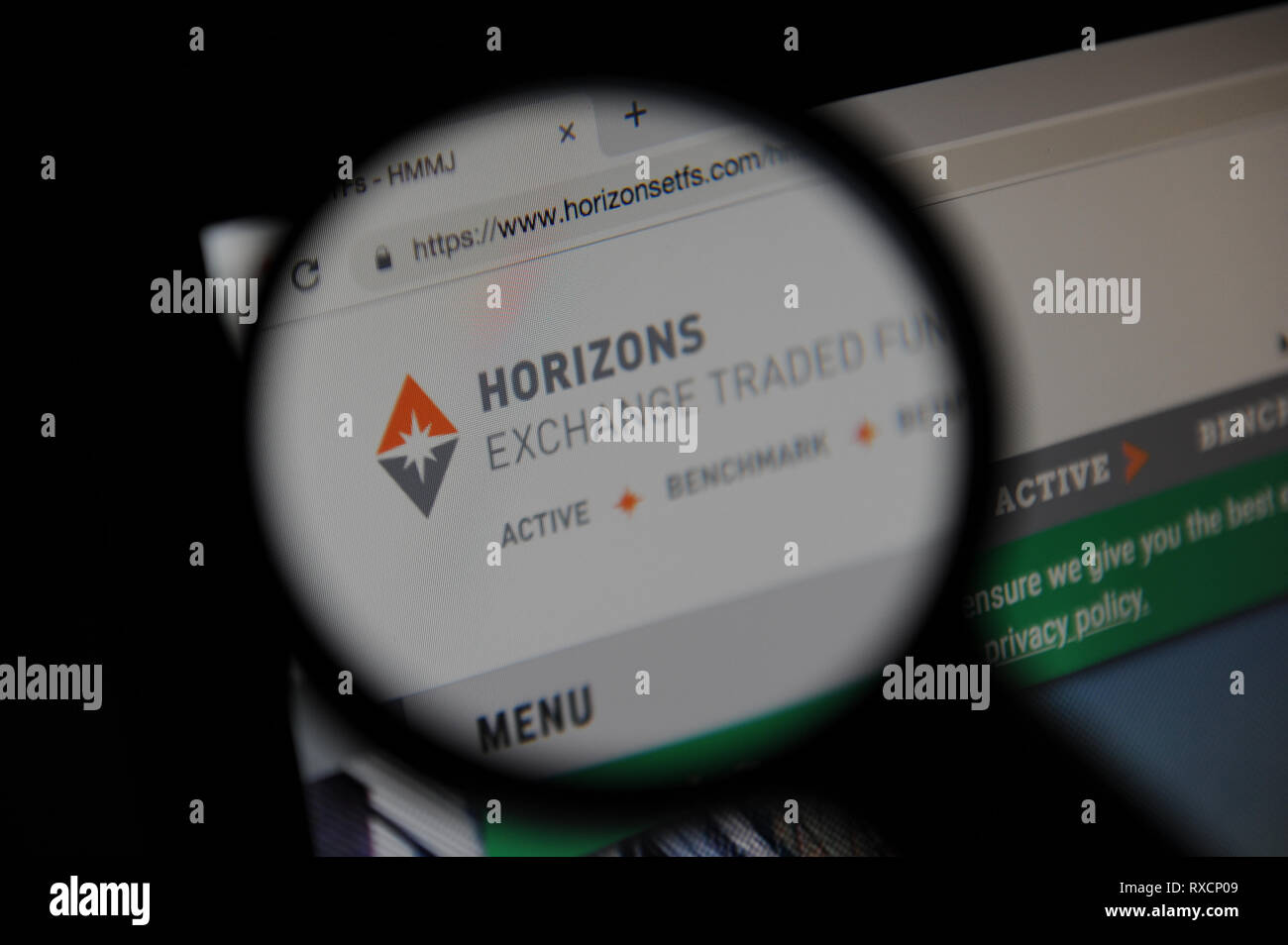Horizons ETFs,  Horizons Exchange Traded Funds website seen through a magnifying glass - Stock Image